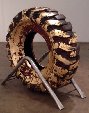 """Earthmover"" 2013 6' x 6' Rubber tire with gold foil. Base is made from welded steel"